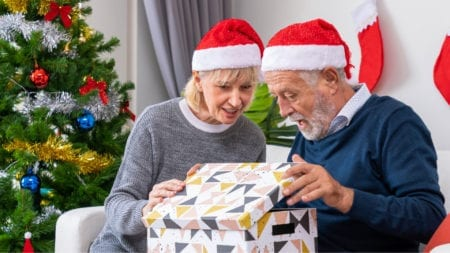 senior opening a christmas gift