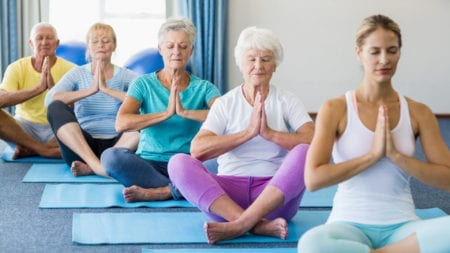 seniors participating in meditation for health benefits