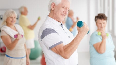 seniors staying active in SilverSneakers class