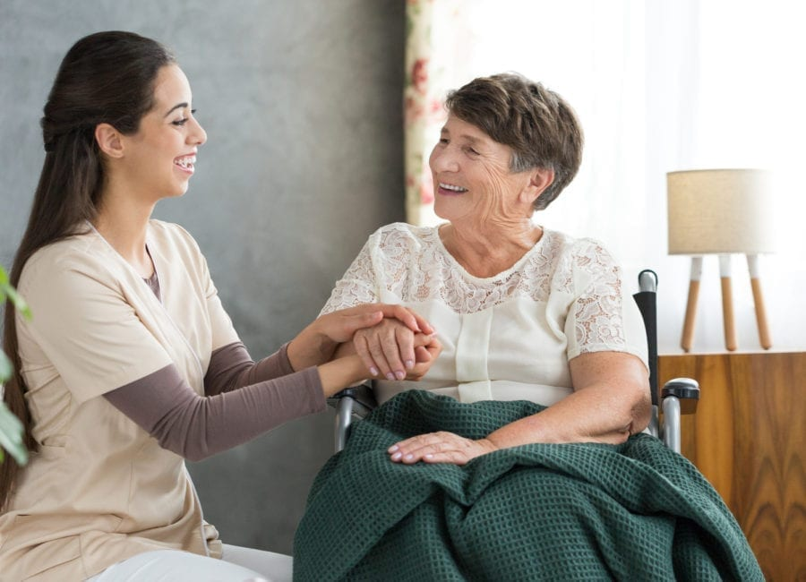 Senior sitting with caregiver to prepare for their time together